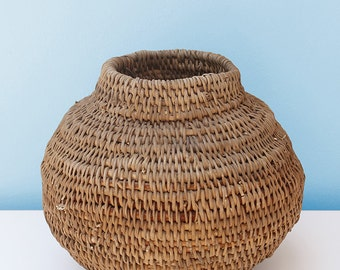 Buhera pot 30cm x 25cm: Buhera Baskets are handwoven by women in the Buhera District, Zimbabwe. They use vines using traditional techniques.