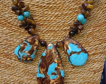 Stunning turquoise and tigers eye necklace with an adjustable sliding knot.