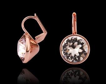 Swarovski crystal dangle earrings.  Clear Swarovski crystal mounted in rose gold
