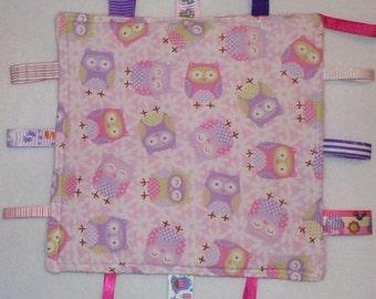 Baby sensory taggie comforter blanket