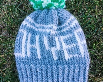 Grey oh yeah hat with green pom pom