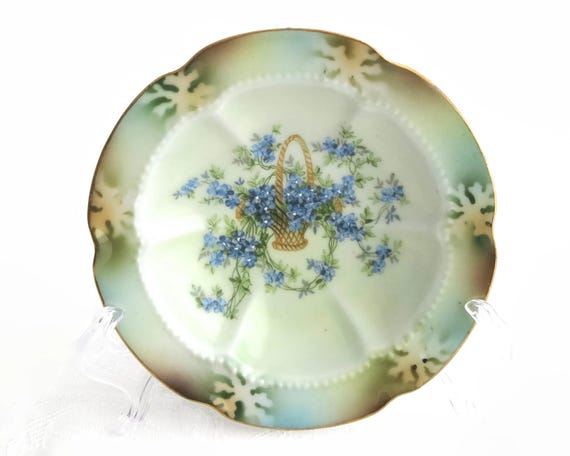 Antique hand painted trinket dish, basket of blue flowers, gilt edge, beaded outline, stencilled pattern on lip, circa 1900