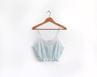 Baby blue lingerie crop top with white lace trim and elasticated waist