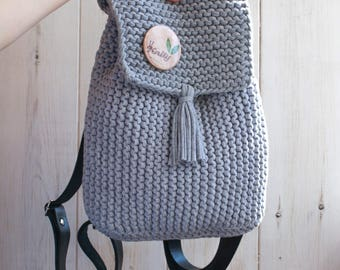 Knitted backpack with leather handles