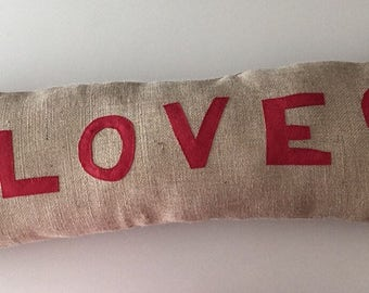 Jute decorative love cushion.