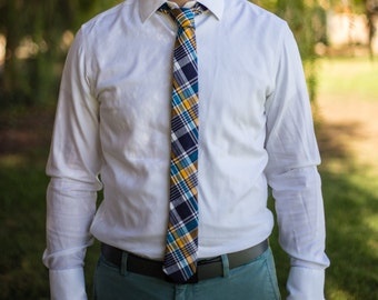 Plaid skinny tie with navy, white, yellow, and blue pattern