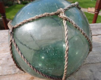 Authentic Extra Large Vintage Glass Fishing Float With Rope Netting Dark Green Chunky Glass Original Used Condition Garden or Home Decor #4