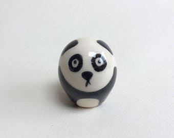Small handmade pottery panda. Each one is unique. Thrown on the potter's wheel and individually painted with delicate brushwork.