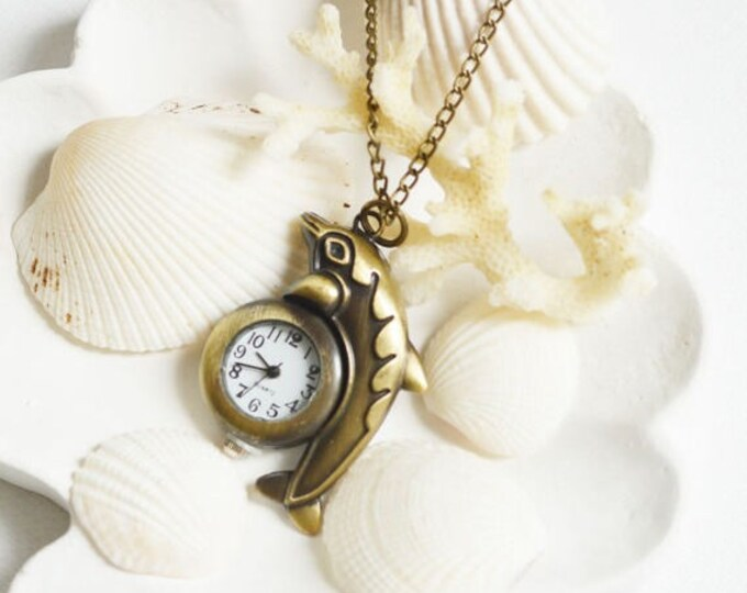 SALE! Once in the Ocean Pendant in the shape of a Dolphin with a clock, metal brass, Nautical