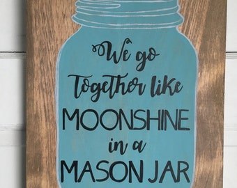 We go together like moonshine in a mason jar. Hand painted wooden sign with a blue painted jar and black lettering, Farmhouse style sign.