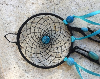 This nice dream catcher in blue and black