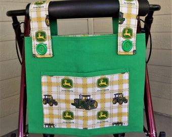 "Walker bag.  Walker Tote.  Bag for walker. John Deere themed.  Green denim with John Deere tractors.  Velcro closure. 15""W x 12""H."