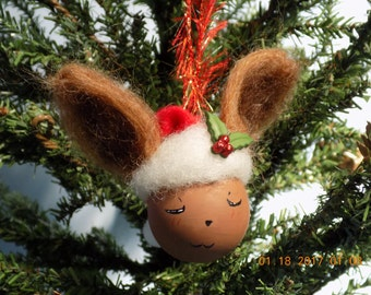 Mini Eevee Pokemon hand painted  2 inch glass ball with santa hat and felted ears