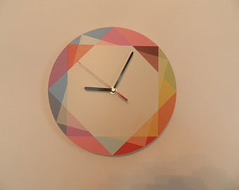 Modern coloured wall clock, red, blue, orange, white, green,  Modern clock. Rainbow coloured modern wall clock,
