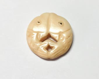 Carved bone bead double sided fish 19mm