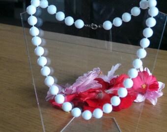 White plastic beaded choker necklace
