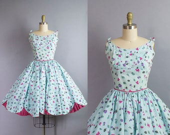 1950s Floral Cotton Sundress/ 50s blue dress with ties shoulders and scalloped hemline/ small (36b/26w)