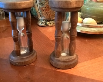 Two vintage hourglasses