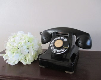 Vintage rotary dial black desk telephone/Northern Electric Company Limited