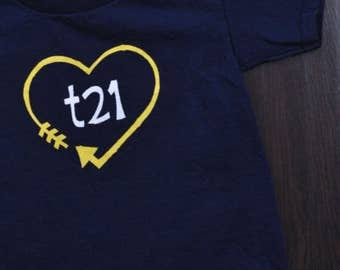"Down Syndrome Awareness Shirts ~ ADULT SIZES - Unisex Men and Women, Navy T-shirt with Yellow and White ""T21"" Logo with Arrow Heart"