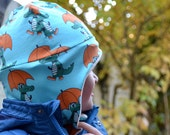Winter hat for babies and kids made of soft organic cotton fleece and jersey, with optional two little fox ears. Dark blue jersey leaves.