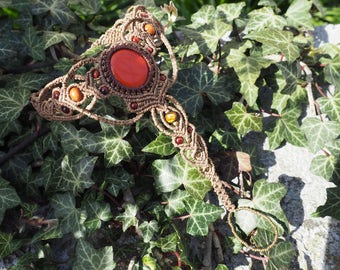 Foot with red Jasper macrame jewelry