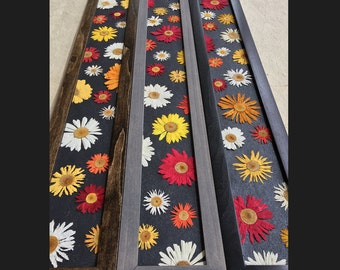 THE SKINNY; Crazy Daisy. Pressed Mixed Coloured Daisies.  Black, Walnut or Grey frame. Hangs horizontally and vertically. Handmade paper