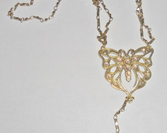 Beautiful vintage Avon goldtone ab rhinestone butterfly pendant necklace with clear faceted crystal accent beads