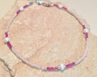 Pink and purple ankle bracelet made with Czech and Miyuki seed beads, sterling silver round beads, tube beads and a silver trigger clasp