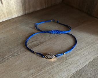 Evil eye bracelet with dark blue string