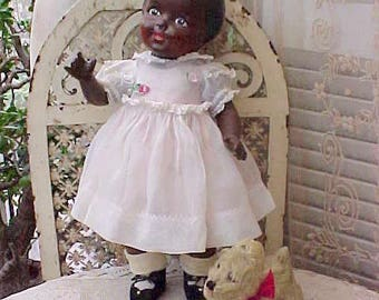 Adorable and Unusual Black Composition Doll