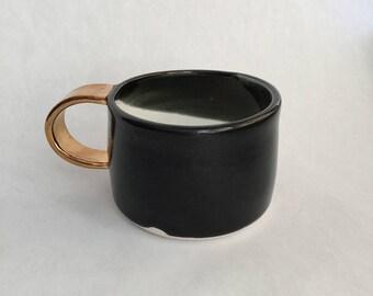 porcelain black and gold mug