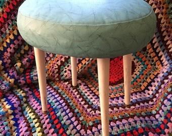 1950 Atomic footstool, turquoise vinyl with black line design