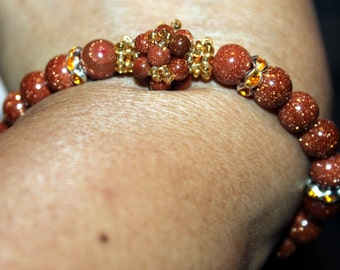 Beautiful gold stone-beaded handmade bracelet; beadweaving, shamballa, goldstone, elegant, golden color