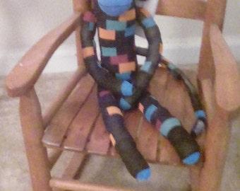 Checkers, sock monkey, a fun companion