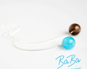 Silver chain smoky quartz ball, blue glass bead with node lock
