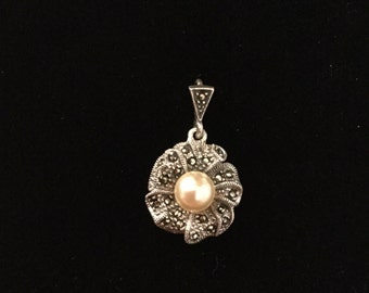 silver and marcasite ribbons make up this pearl wreath pendant