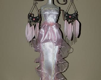 Victorian mannequin jewelry stand with earrings