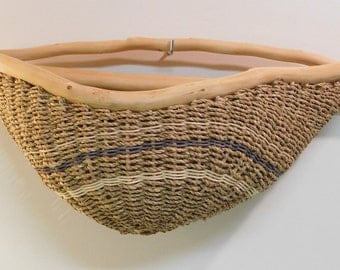 Handwoven seagrass basket/wall hung basket/tree branch framed/natural and blue round reed accent/rustic/cabin/Boho