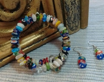 Blue beaded memory wire bracelet with matching earings.