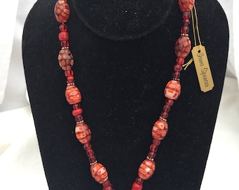 Red Glass Bead Necklace With Asymmetrical Central Bead Pair