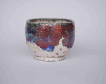 Cup of te raku copper and blue