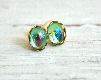 Vintage green glass peridot studs,aurora borealis studs,small post earrings. Tiedupmemories