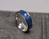 1/4 inch wide argentium sterling silver & anodized titanium riveted spinner ring worry ring fidget ring
