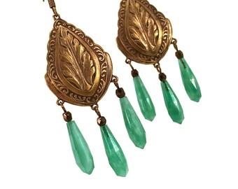 Chandelier earrings in vintage bronze with emerald green glass drops