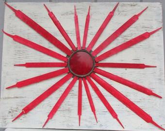 Red Sunburst Assemblage on Barn Wood
