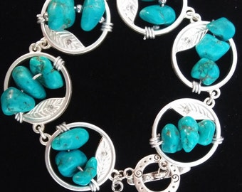 Silver metal bracelets, one with organic shaped howlite( Turquoise) The other turtles ( Howlite)