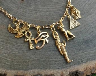 Egyptian Eye of Horus, Winged Goddess Pyramid, Bastet, gold charm necklace