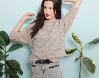 Knitted pastel sweater with fringes EASE