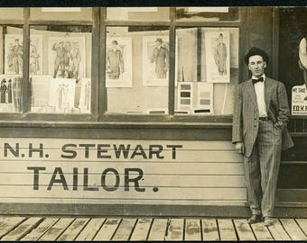 Early 1900s TAILOR SHOP EXTERIOR N.H. Stewart with Advertising Signs in the Windows Photo Postcard circa 1910